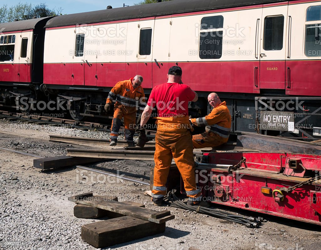Laying rails to deliver a steam engine to the track stock photo