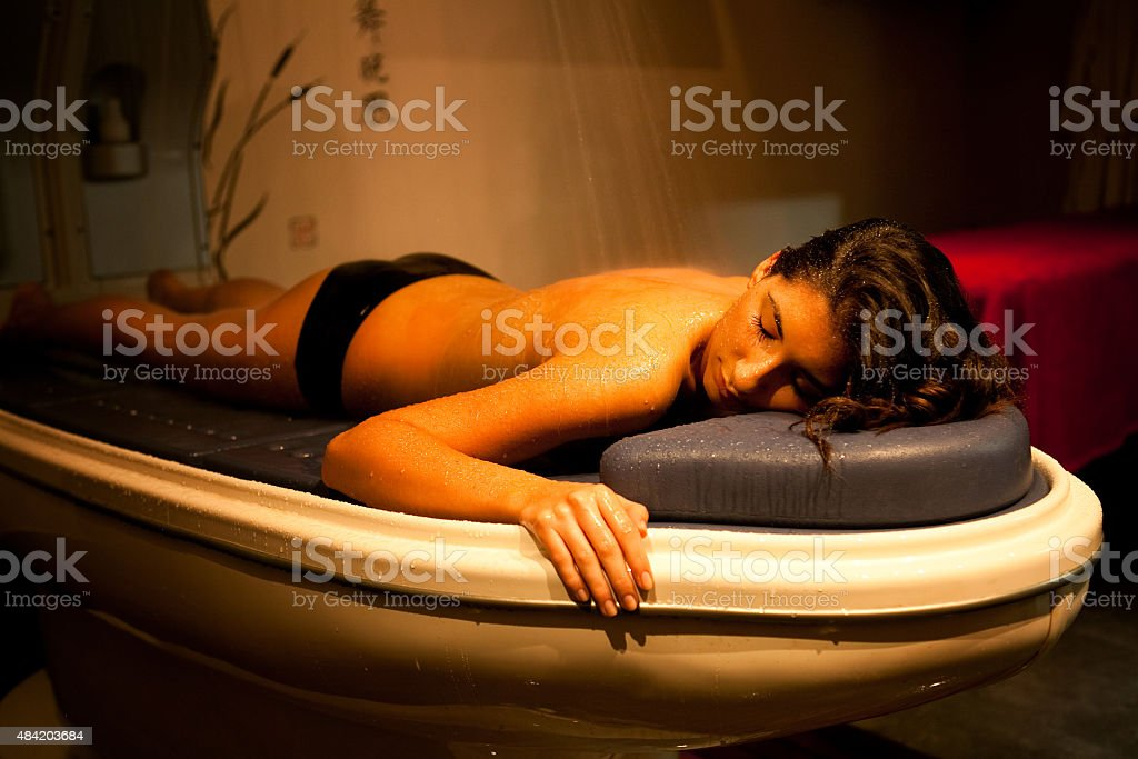Laying relaxed woman during spa treatment. stock photo
