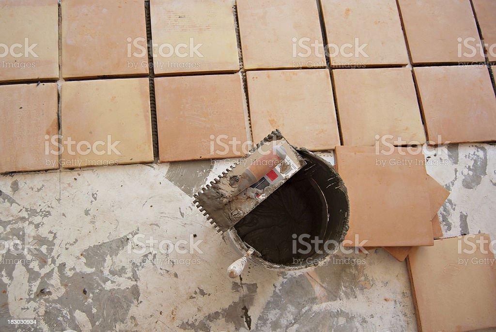 Laying Saltillo Floor Tiles stock photo