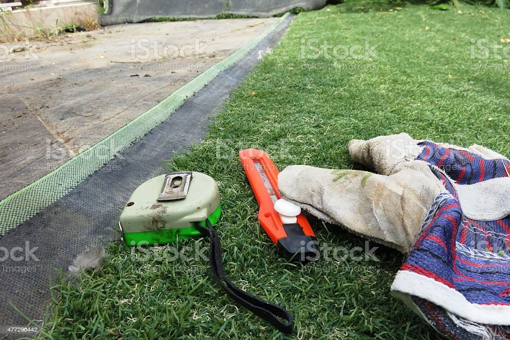 Laying synthetic grass stock photo