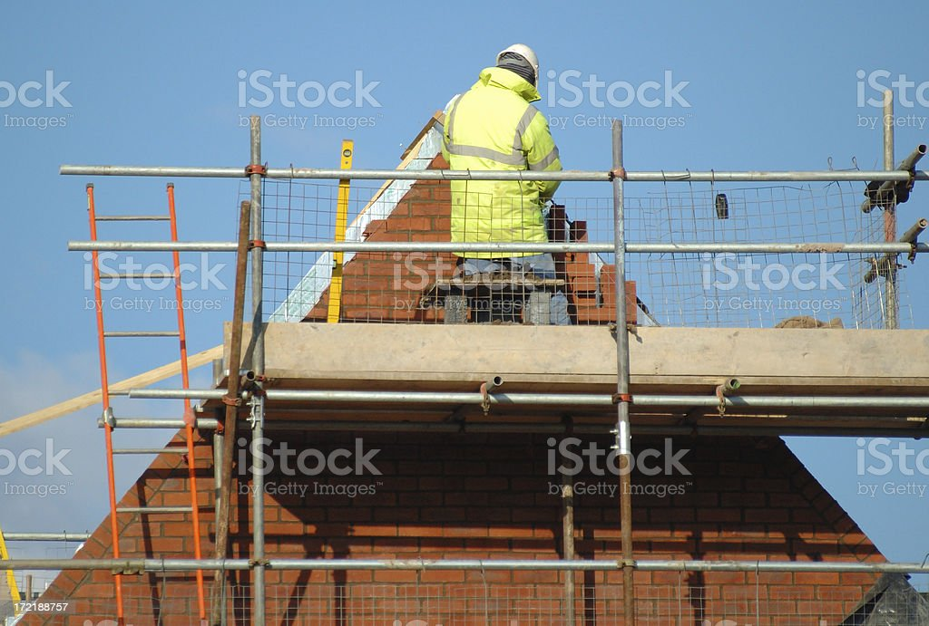 laying the last brick royalty-free stock photo