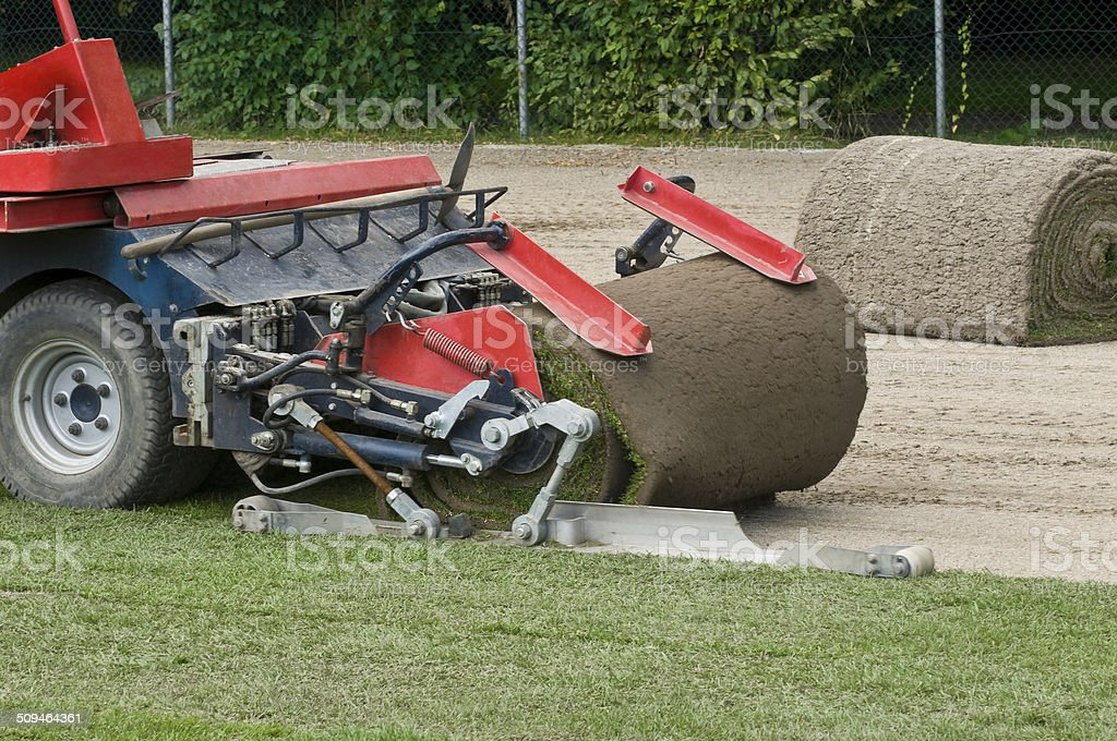 Laying the turf by a machine stock photo