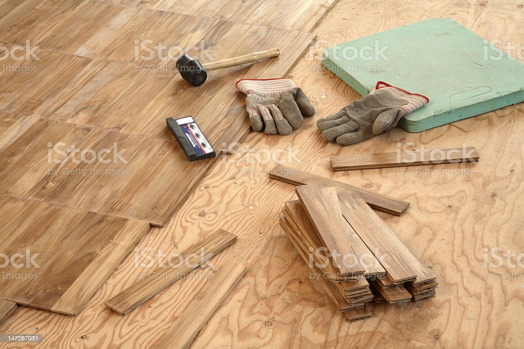 Laying wood flooring stock photo