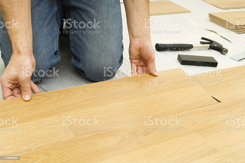 Laying wooden flooring stock photo