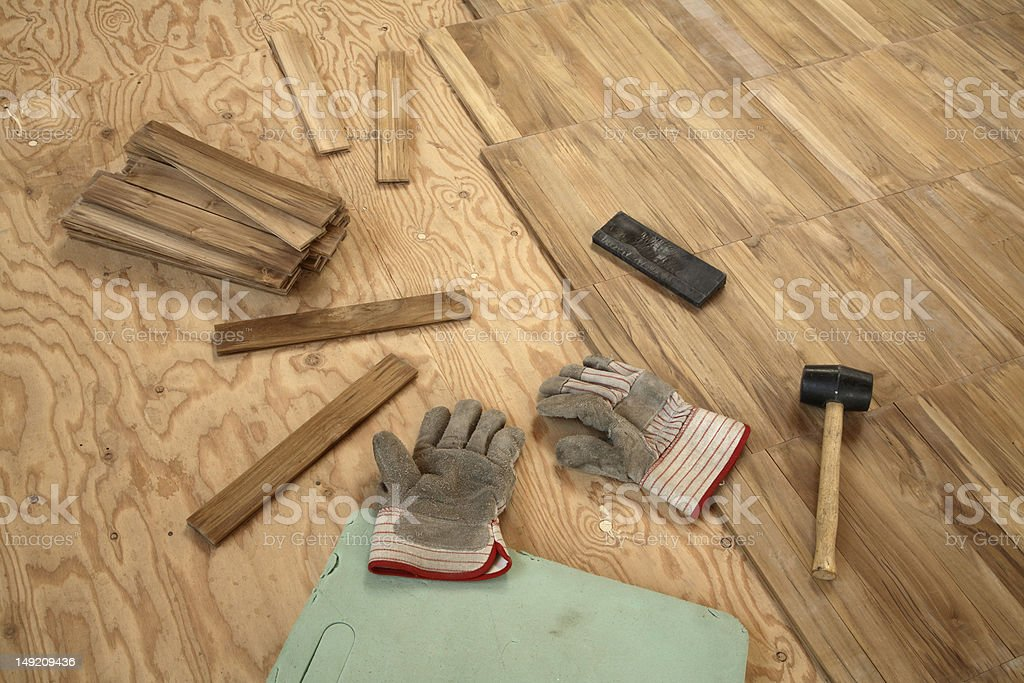 Laying wooden parquet flooring. stock photo