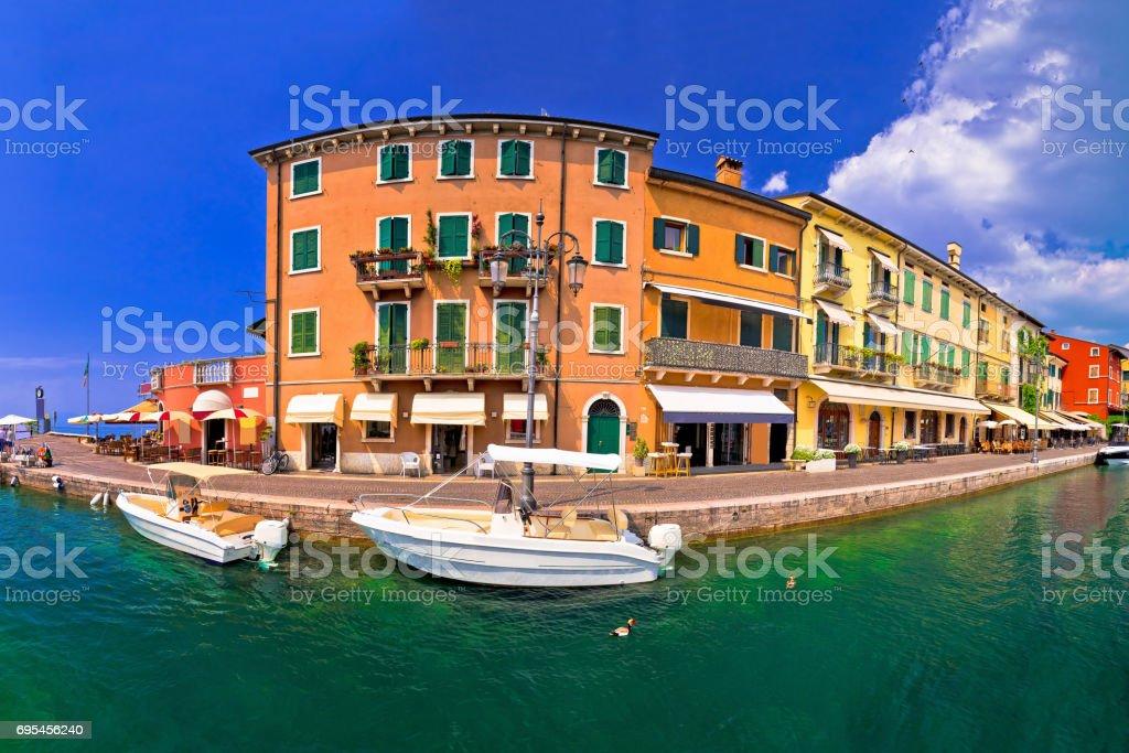 Lazise colorful harbor and boats panoramic view, Lago di Garda, Veneto region of Italy stock photo