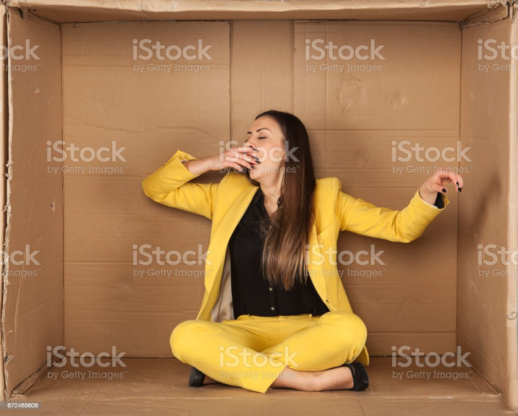 lazy girl in an empty box stock photo