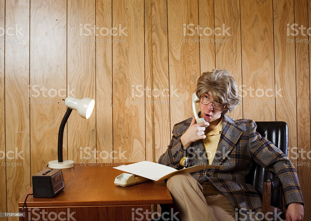 Lazy Office Worker in 1970s Work Space royalty-free stock photo