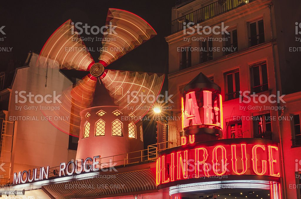 Le Moulin Rouge cabaret in the night on Paris royalty-free stock photo