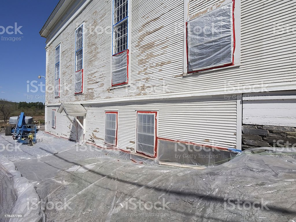 Lead paint removal at building royalty-free stock photo