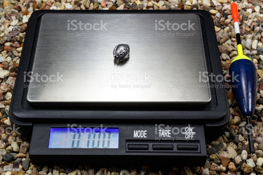Lead weight for fishing float with pocket scale stock photo