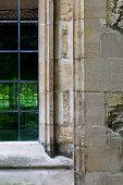 Leaded glass window in limestone wall