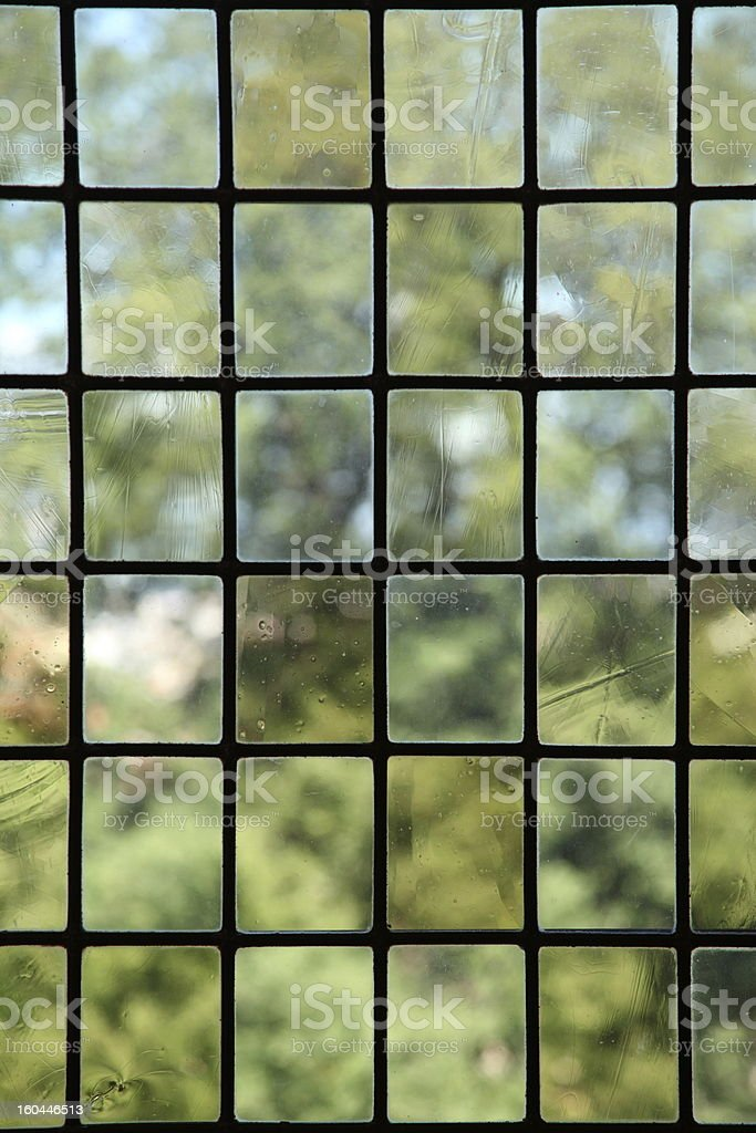 Leaded window in the Royal Kings of Mallorca castle stock photo