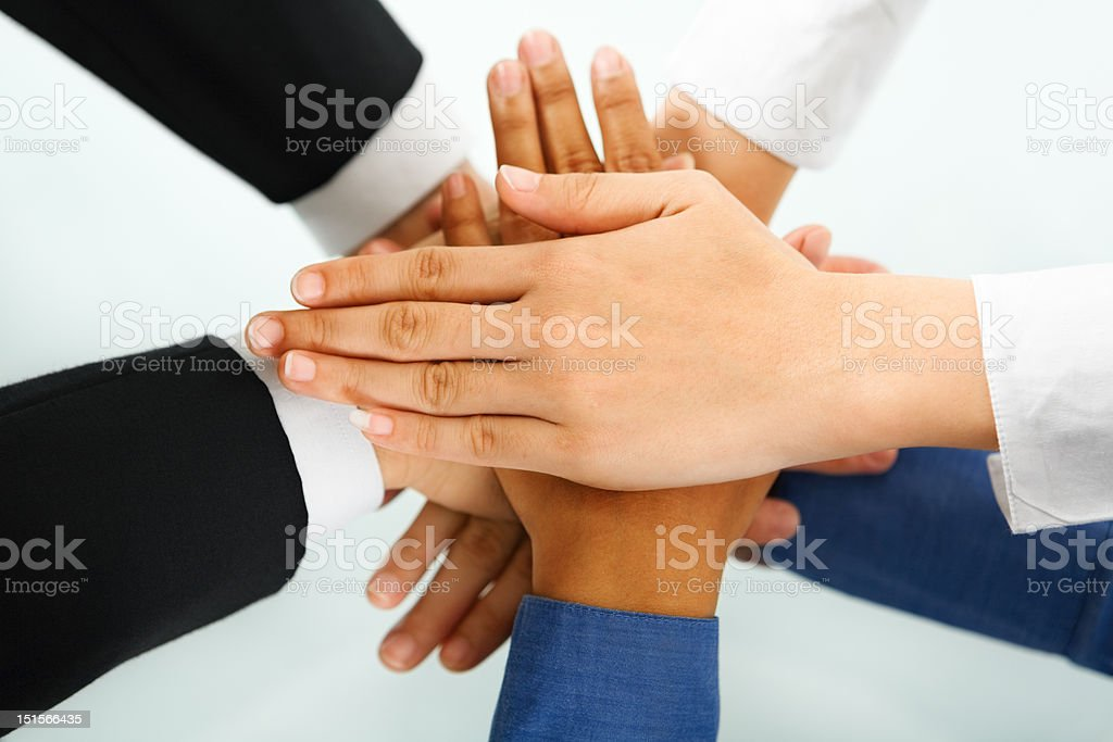 Leader and his employees hands in unity royalty-free stock photo