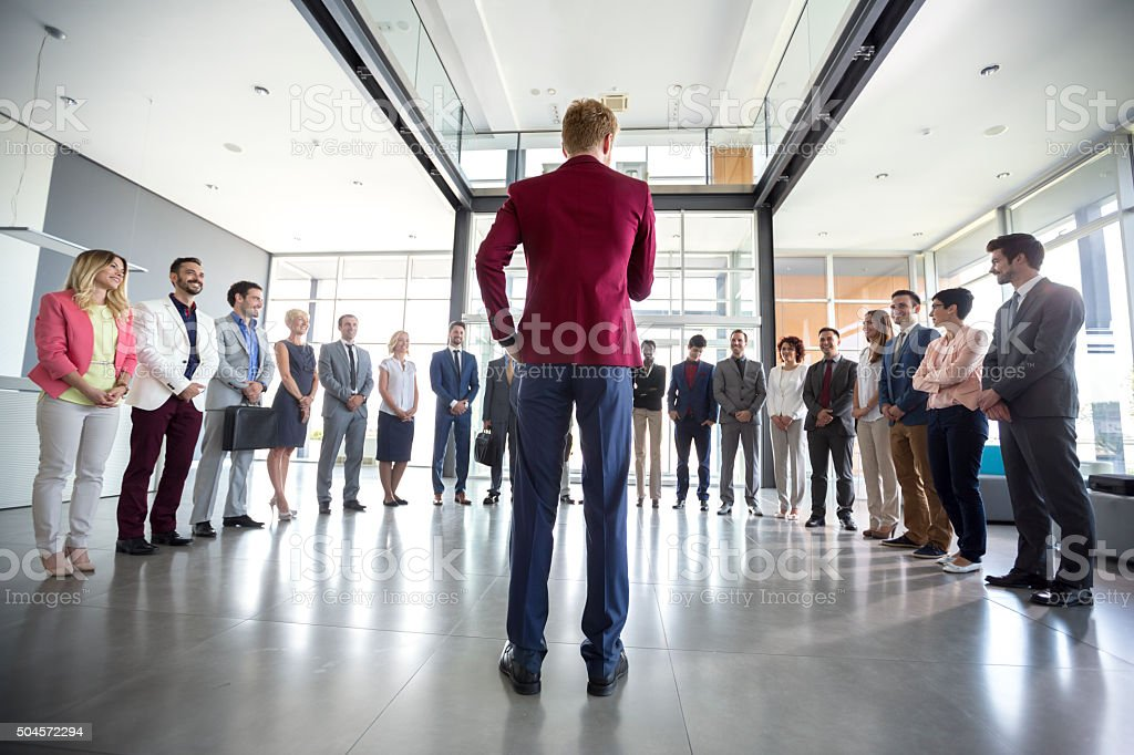 Leader hold meeting with his team stock photo