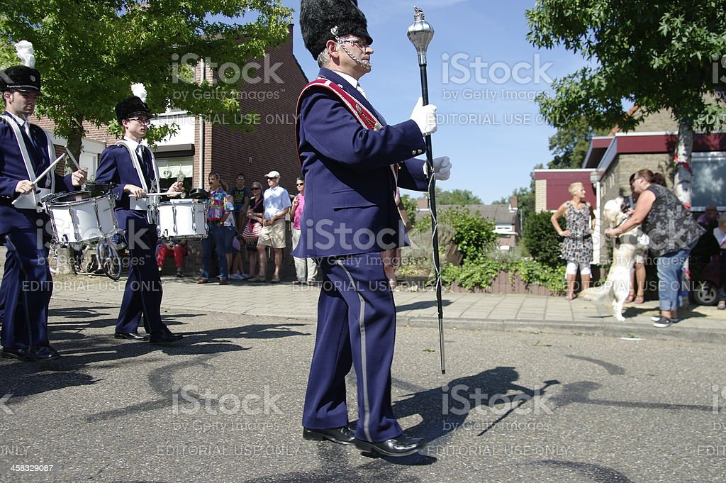 Leader is marching in front of the band stock photo