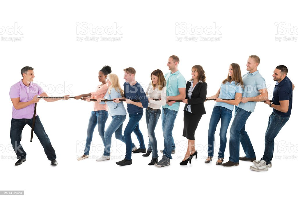 Leader Pulling Creative Business Team While Playing Tug Of War stock photo