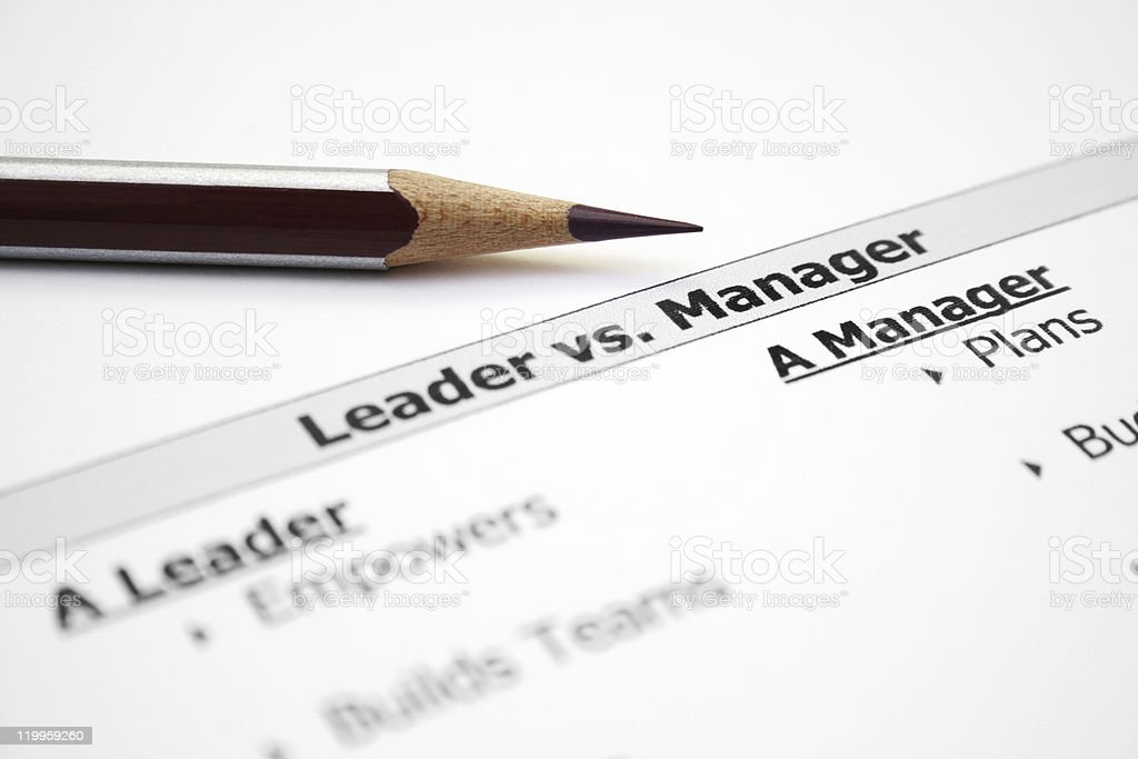 Leader vs. manager royalty-free stock photo