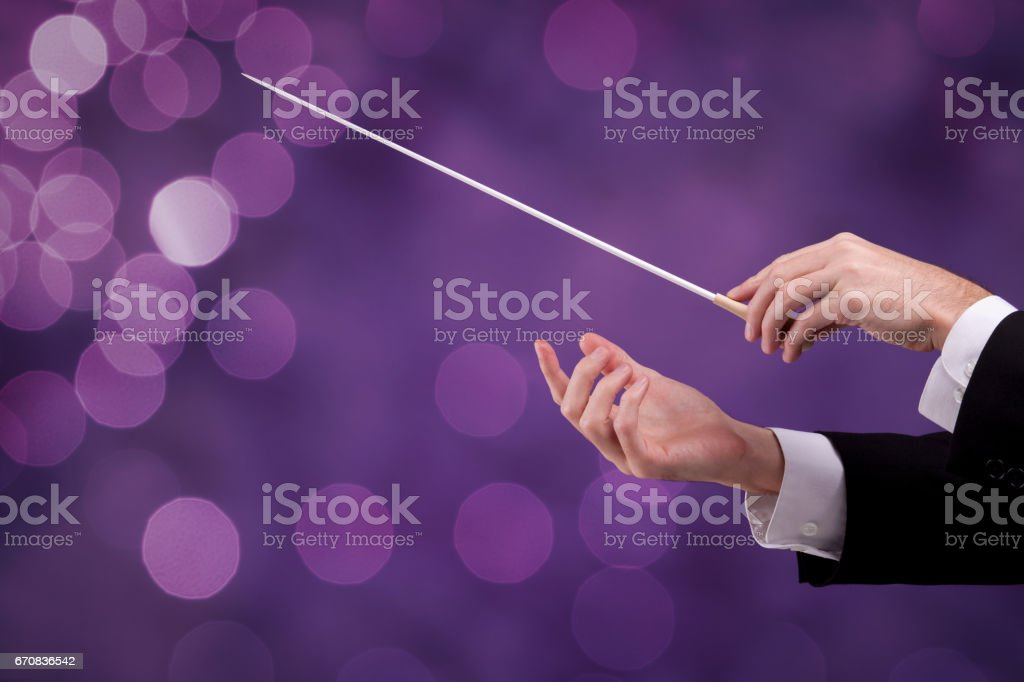 Leadership and manager concepts - orchestra conductor stock photo