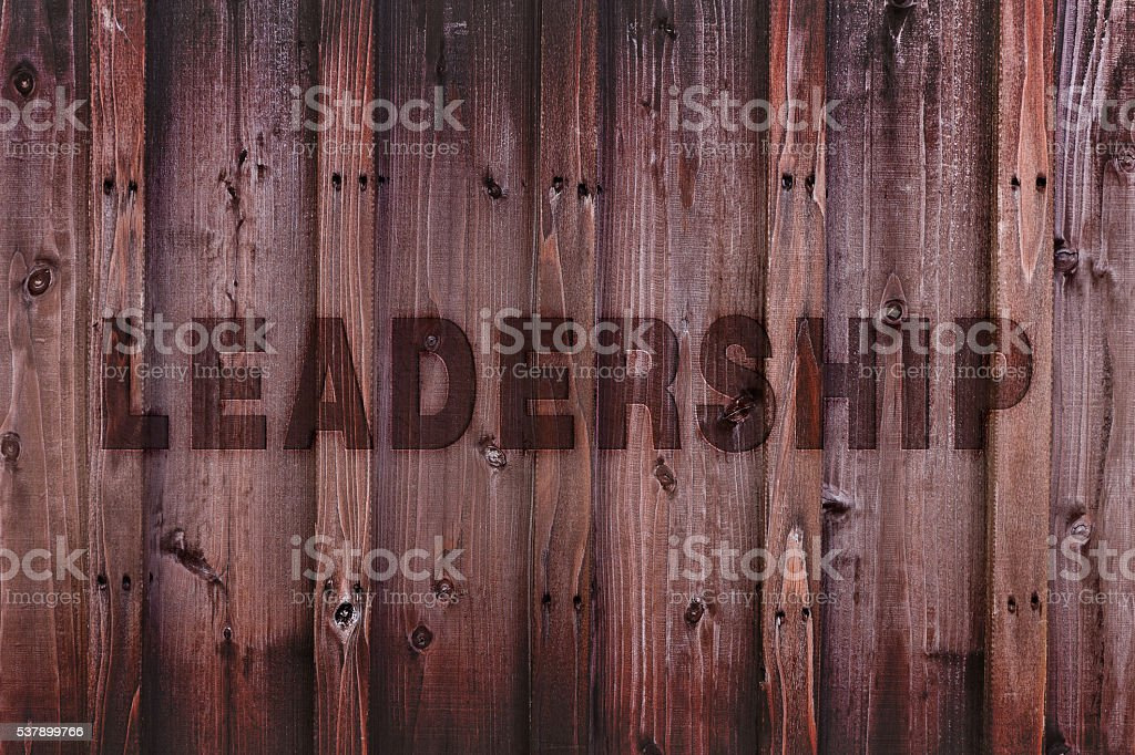 Leadership Concept Background / Leadership Word Engraved on Wood stock photo