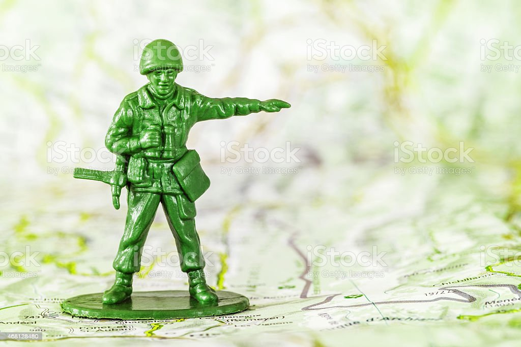 Leadership concept with little soldier toy on map aiming stock photo