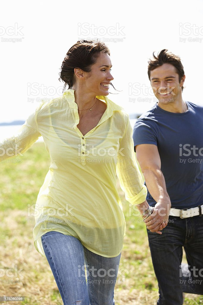 Leading him wherever she wants royalty-free stock photo