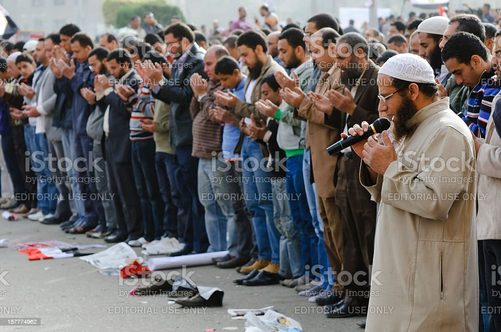 Leading Muslim men in prayer stock photo