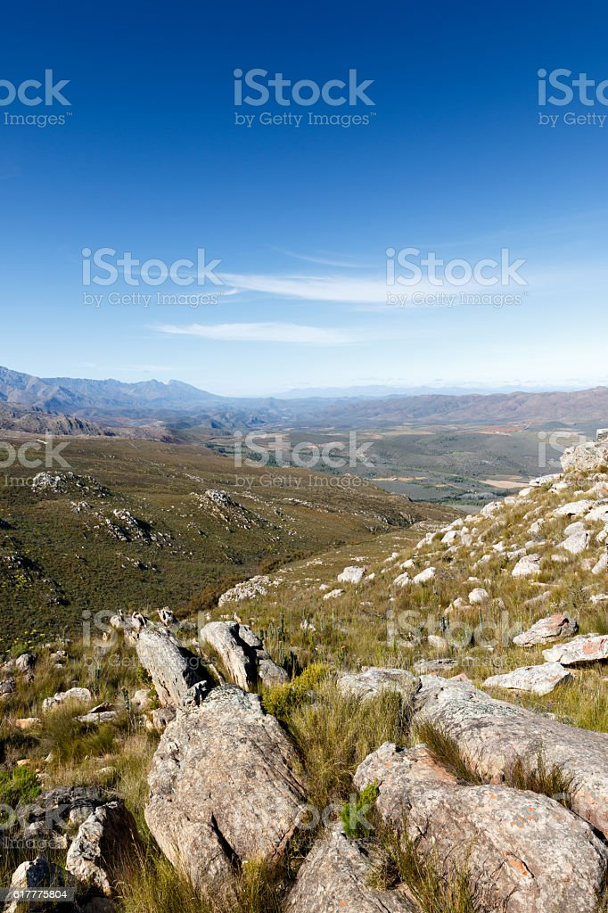 Leading rocks to a valley in the Swartberg mountains stock photo