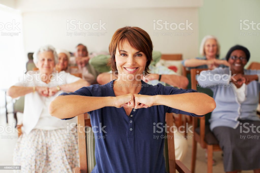 Leading the elderly in their fitness regime stock photo
