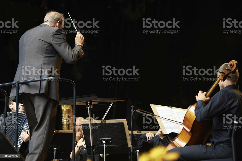 Leading the orchestra in a symphony stock photo