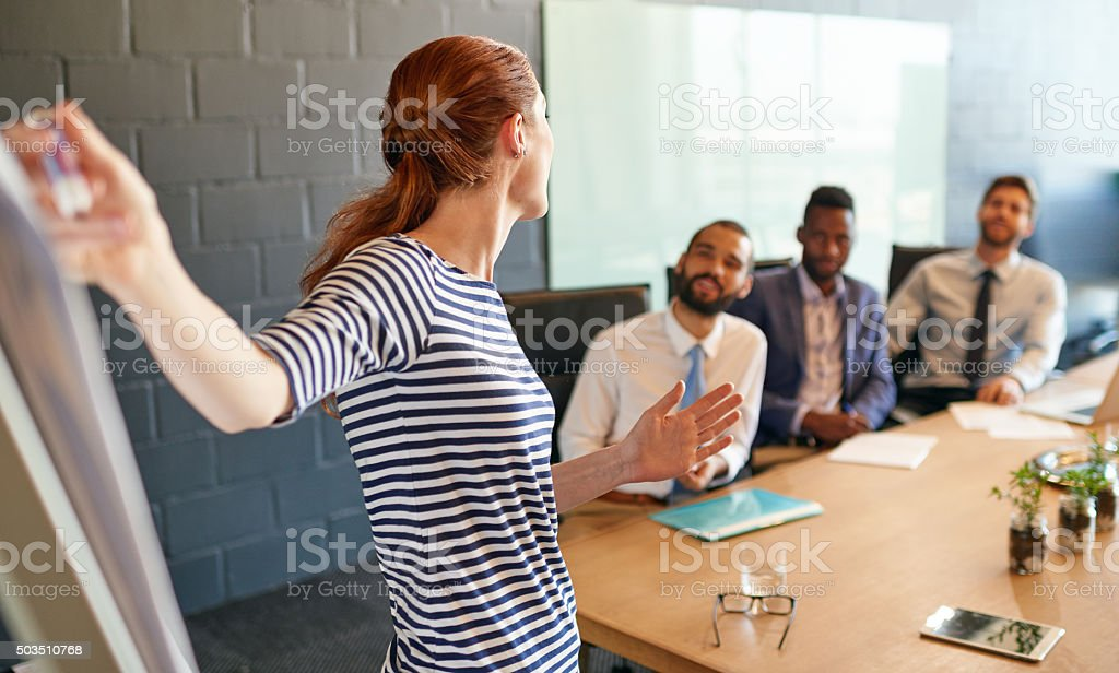 Leading the team in a brainstorming session stock photo
