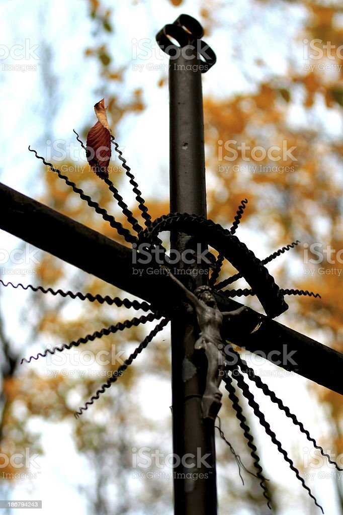 Leaf on the cross stock photo