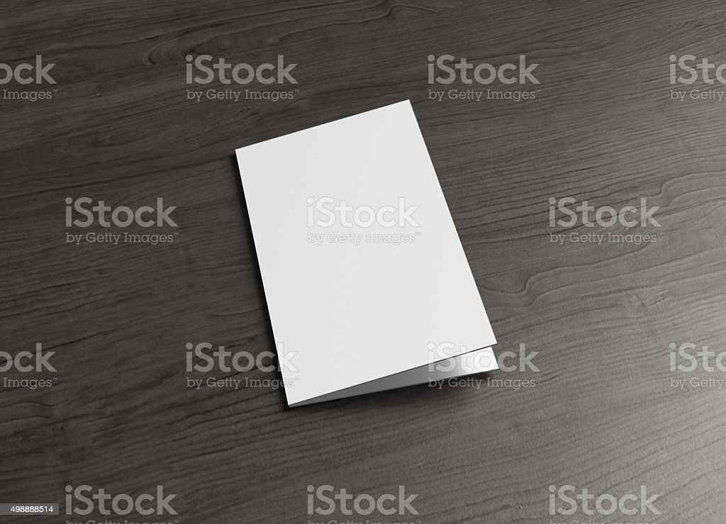 leaflet cover page on wood table stock photo