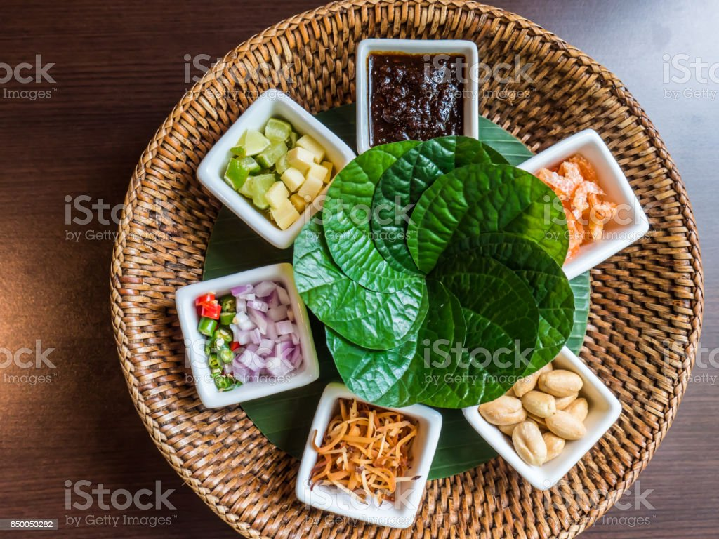 Leaf-wrapped bite-size appetizer stock photo