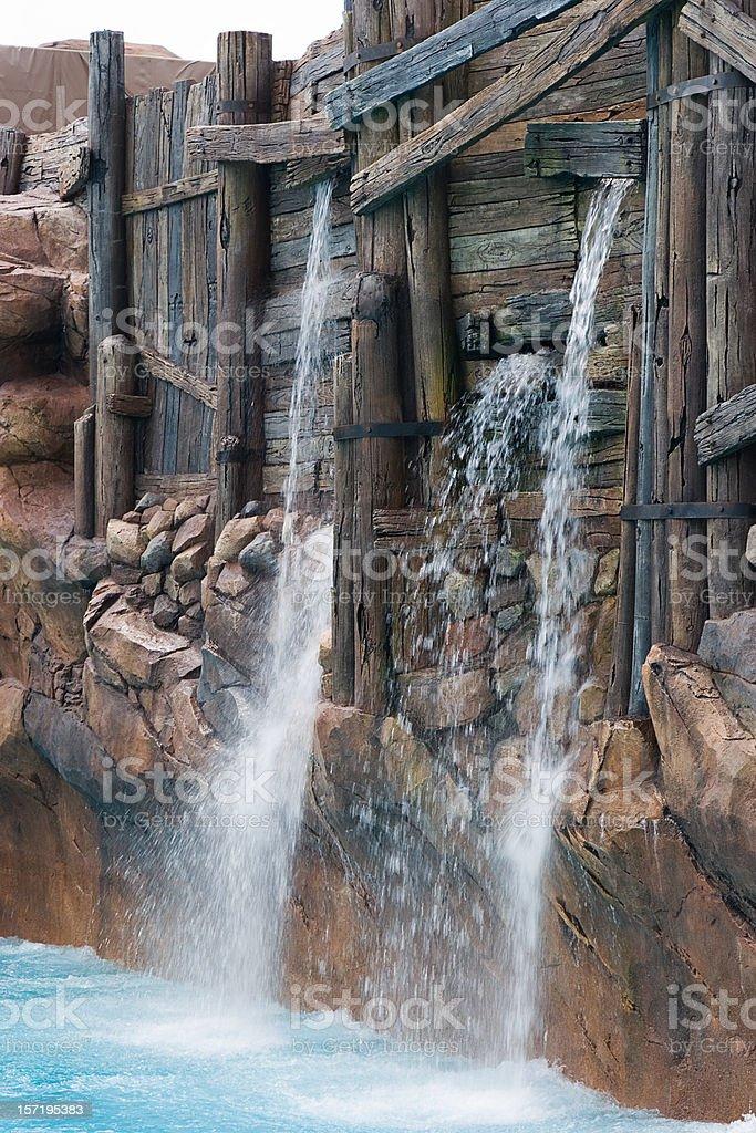 Leak in the dam royalty-free stock photo