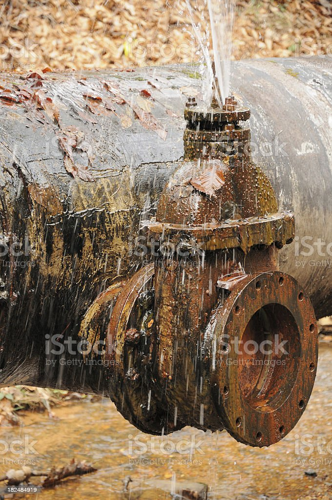 Leaking valve in outdoor pipeline royalty-free stock photo