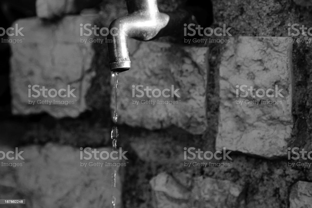 Leaky faucet water in black and white stock photo