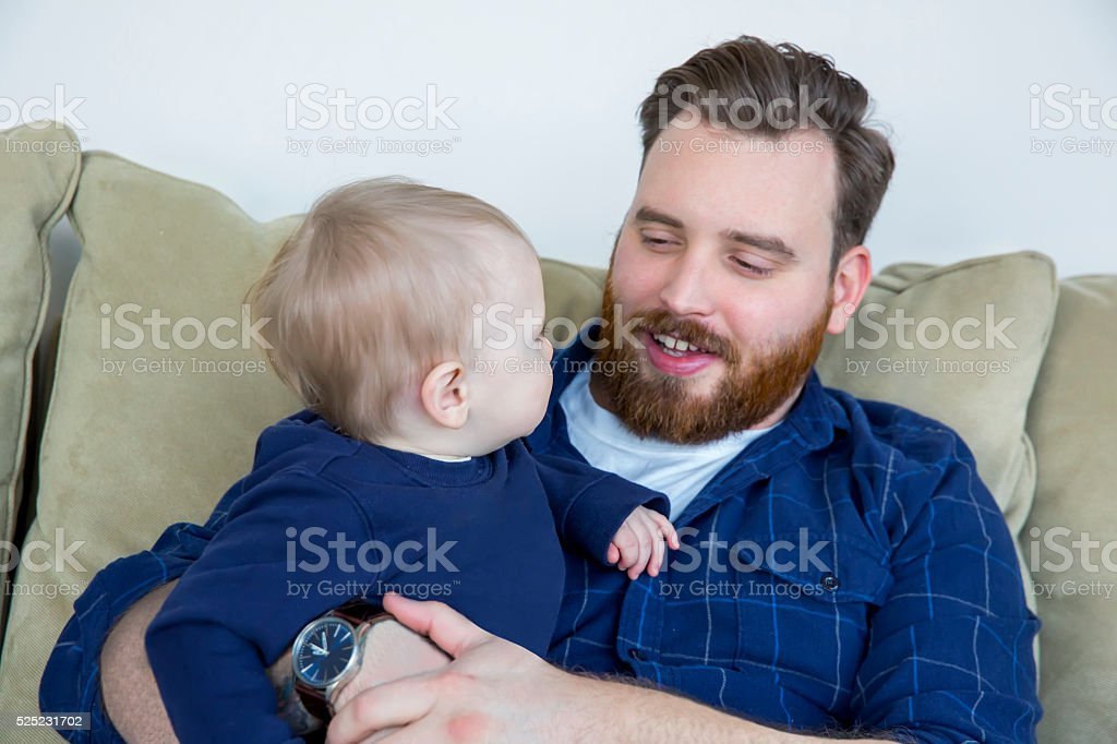 'Lean in Concept 'Real father with one year old son stock photo
