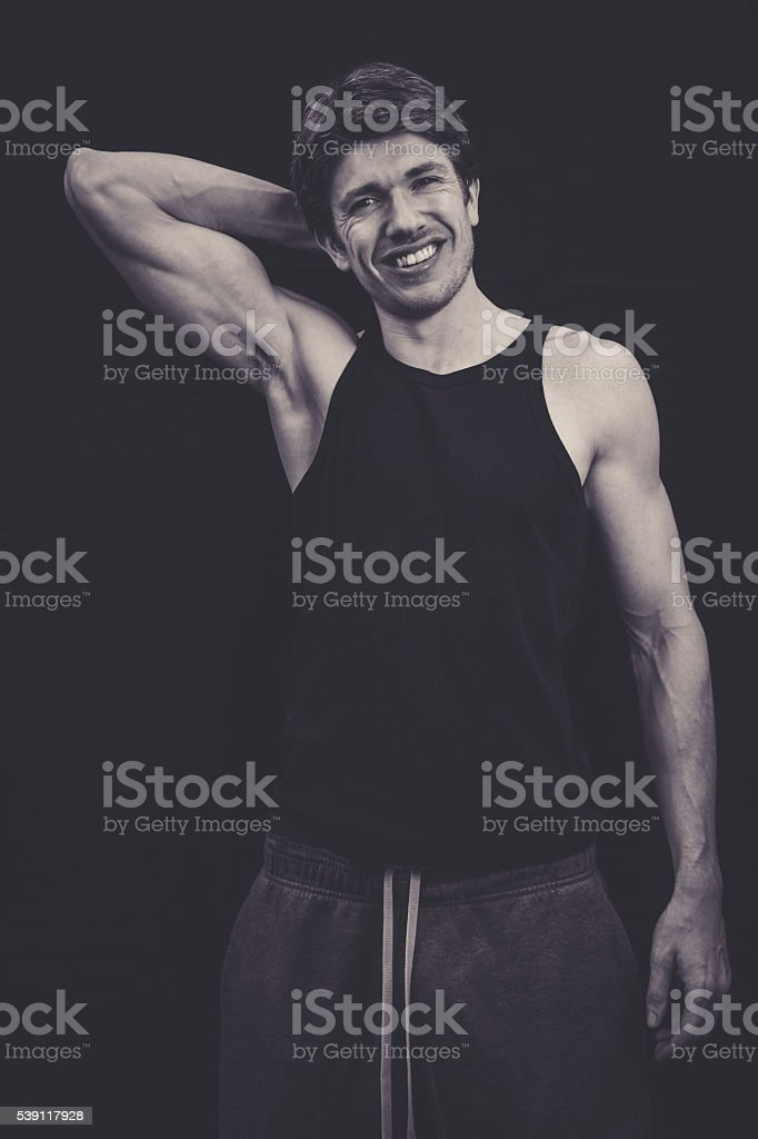 Lean man in vest top in studio stock photo