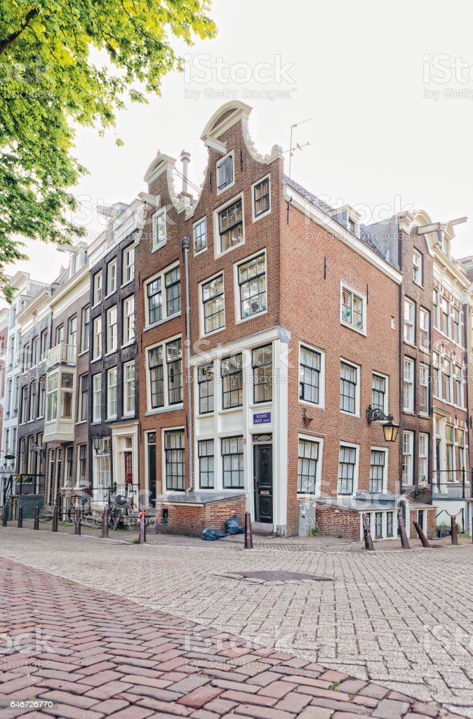 Leaning corner house in Amsterdam stock photo