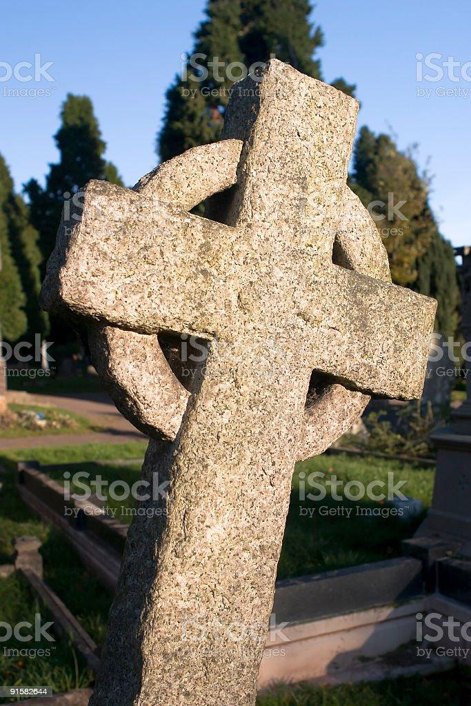 leaning granite cross royalty-free stock photo