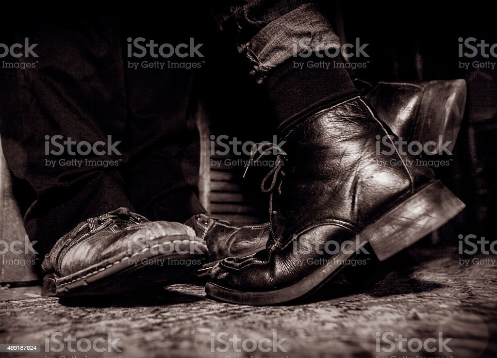 leaning in for a kiss, implied by shoes royalty-free stock photo