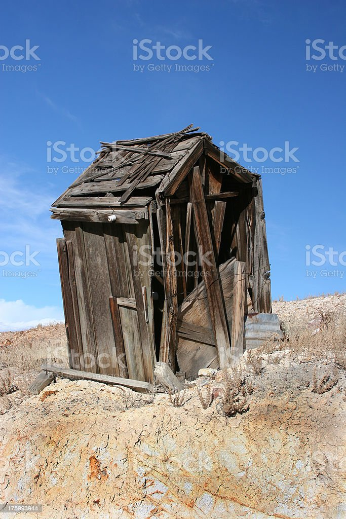 Leaning Outhouse royalty-free stock photo