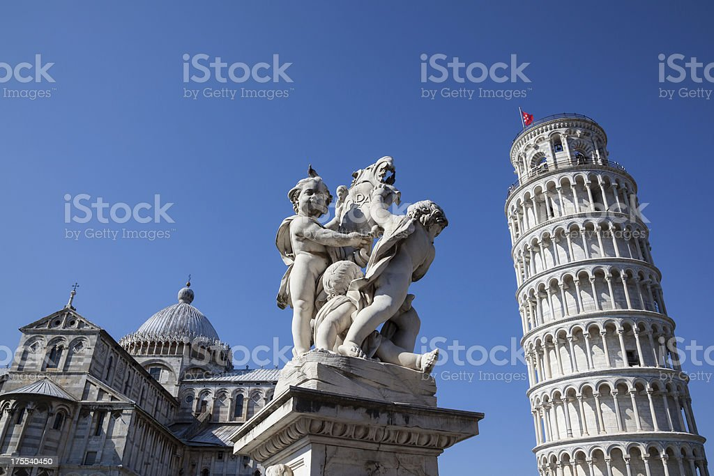 Leaning Tower of Pisa with Statue of Cherubs, Pisa, Italy stock photo