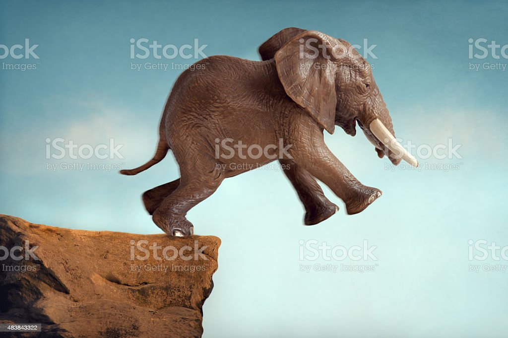 leap of faith concept elephant jumping into a void stock photo