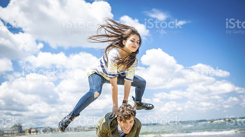 Leapfrog on the beach stock photo