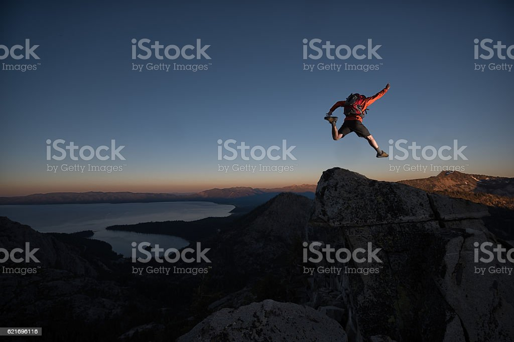Leaping into the void of Lake Tahoe Mountains stock photo