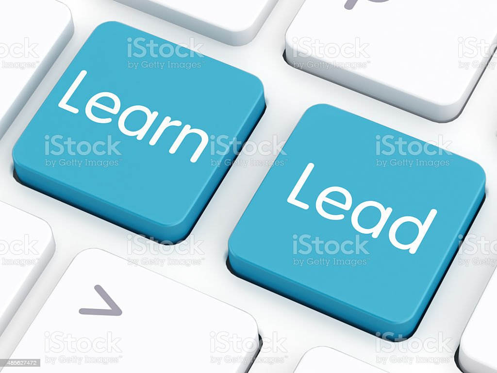 Learn and Lead on keyboard keys stock photo
