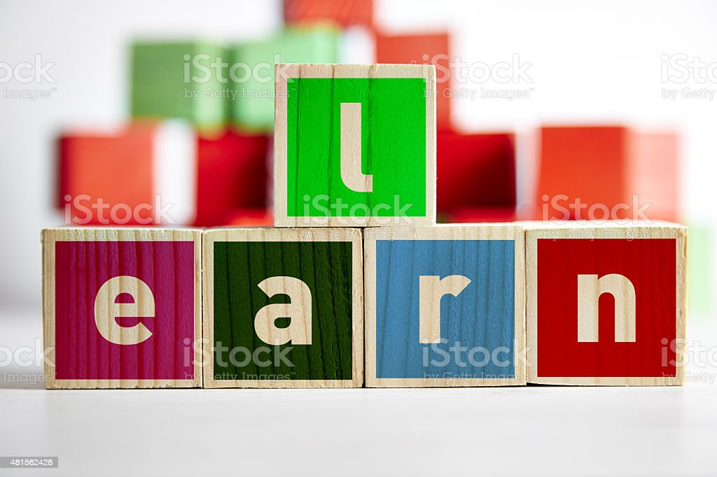 Learn word wooden toy cubes stock photo
