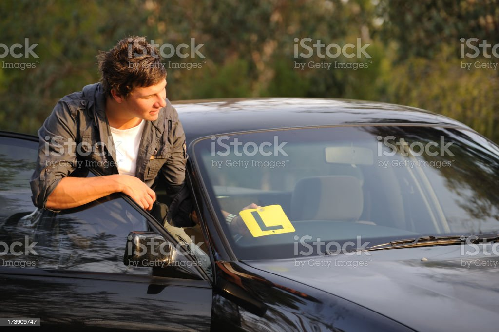 Learner Driver attaching L Plate stock photo
